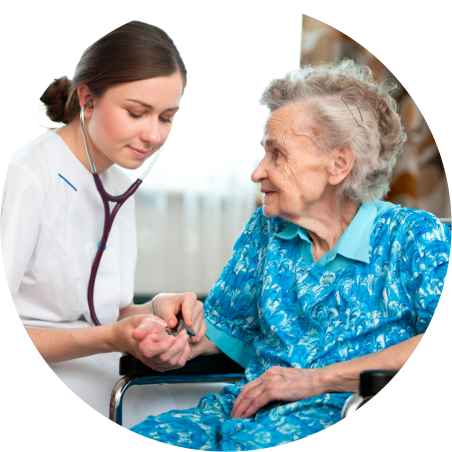 caregiver checking elderly woman's pulse